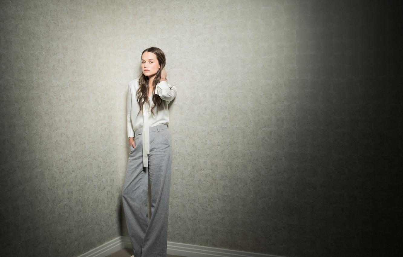 Photo wallpaper girl, wall, hair, blouse, pants, gentle, Alicia Vikander, Alicia Vikander