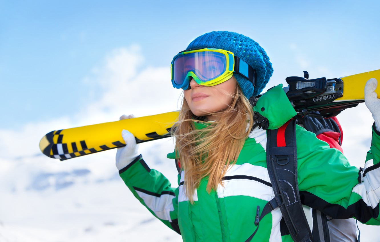 Photo wallpaper winter, the sky, girl, snow, mountains, pose, background, hat, ski, glasses, jacket, blonde, gloves, athlete, …