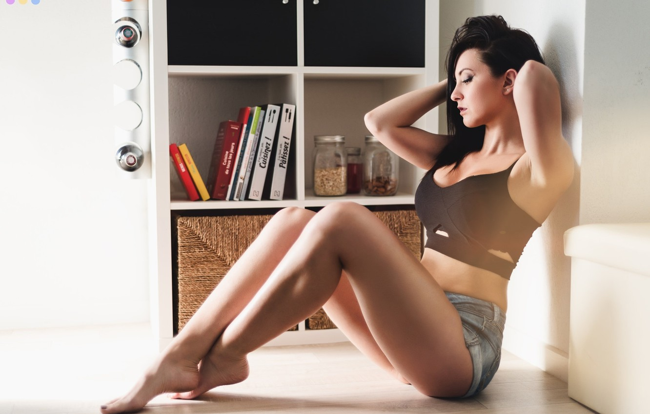 Photo wallpaper girl, pose, shorts, books, makeup, figure, brunette, hairstyle, banks, topic, legs, sitting, on the floor, …