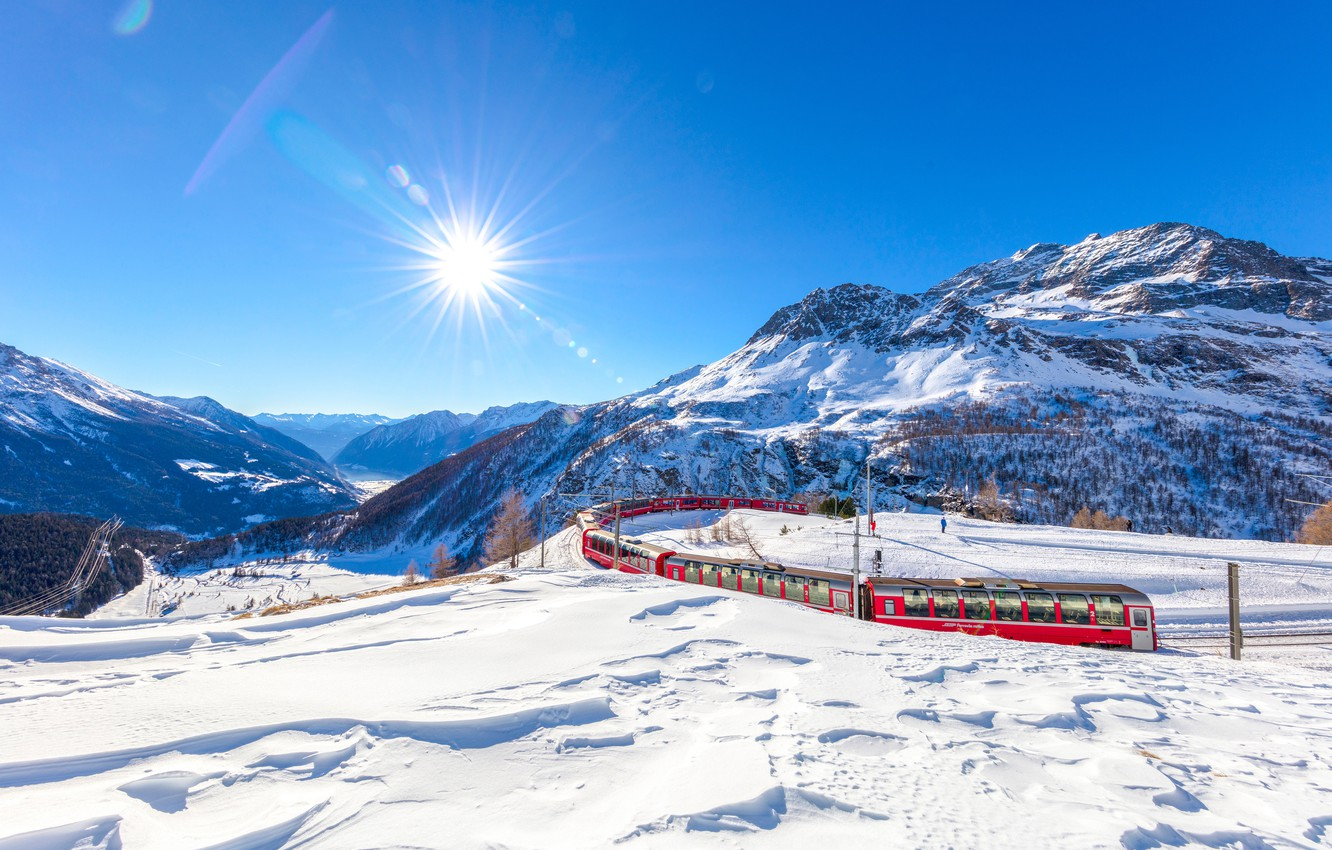 Photo wallpaper winter, the sky, the sun, rays, snow, trees, mountains, train, Switzerland, valley, Alps, railroad, Graubunden