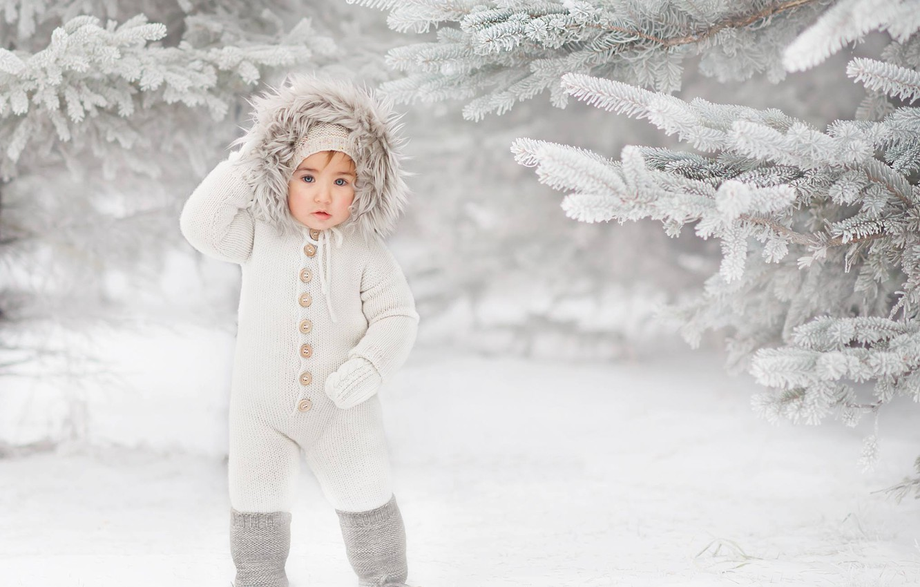 Photo wallpaper winter, snow, branches, boy, ate, hood, jumpsuit, child