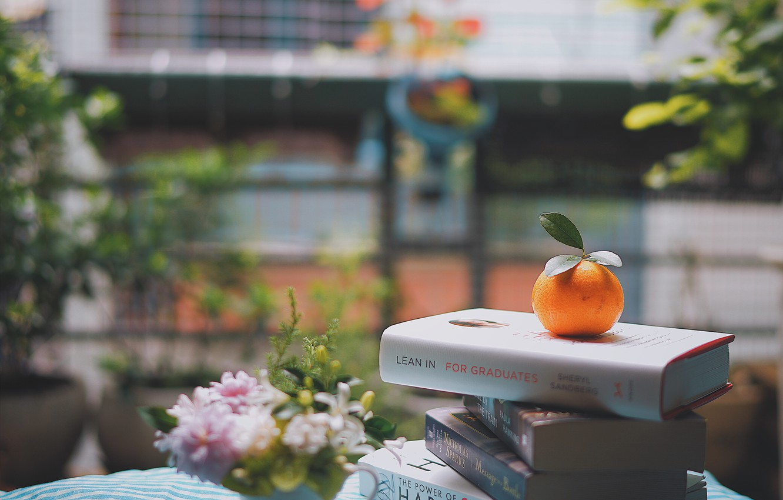 Photo wallpaper flowers, street, books, orange