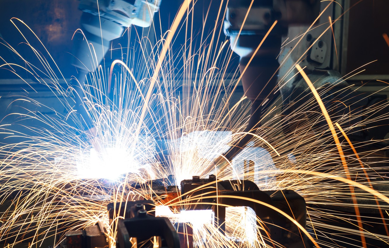 An industrial welder robot, with bright sparks flying everywhere.