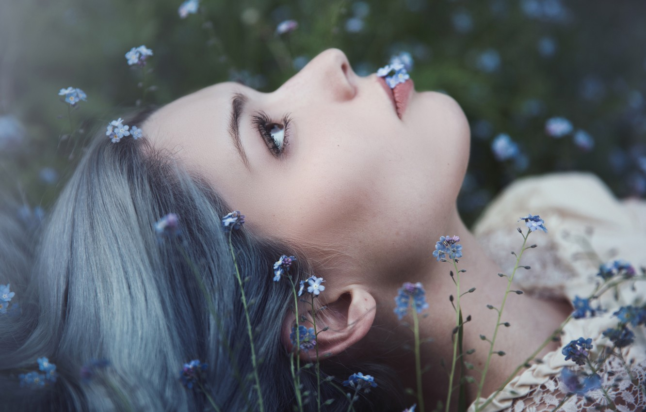 Photo wallpaper eyes, look, girl, flowers, close-up, nature, face, background, glade, portrait, lies, profile, forget-me-nots, looking up