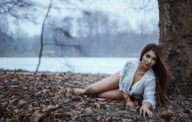 Photo wallpaper autumn, leaves, girl, trees, snowflakes, river, barefoot, makeup, hairstyle, lies, blouse, white, brown hair, bokeh, …