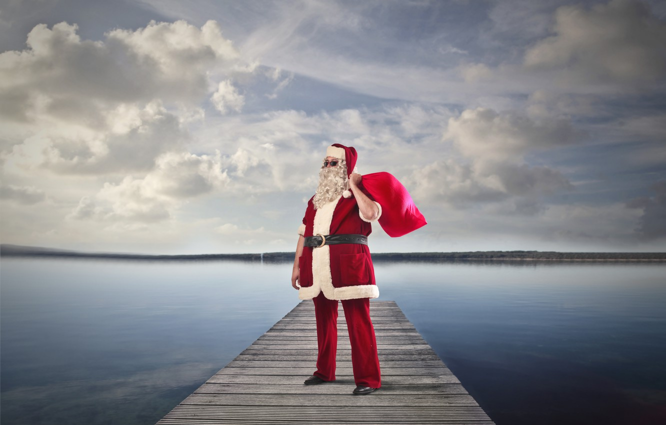 Photo wallpaper the sky, clouds, river, holiday, shore, hat, pier, glasses, Christmas, gifts, New year, coat, beard, …