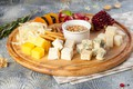 Picture dried fruits, cuts, cheese, honey, garnet