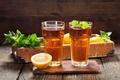 Picture glasses, lemons, table, drink