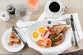 Picture sausages, Breakfast, bacon, scrambled eggs, coffee, toast, croissant, tomato