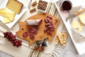Picture cheese, grapes, crackers, baguette, tray, red wine, sausages, figs, pate, cutting Board, pig