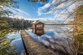 Picture forest, lake, house, the bridge, Finland