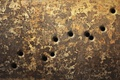 Picture the gun turn, through holes, metal, texture, wallpaper., wall, surface, scratches