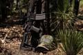 Picture assault rifle, forest, cap